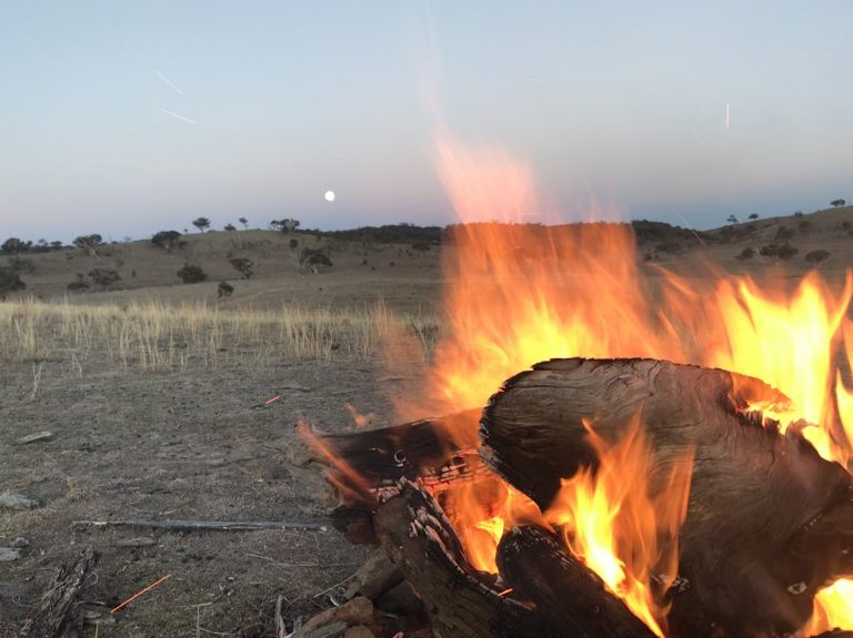 Camp fire at dusk. Glenayr Farm Luxury Glamping and Villas