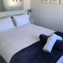 Queen bed in guest room.