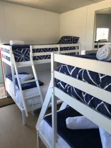 Two bunk beds in room