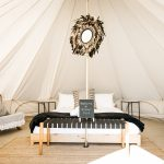 Luxury glamping tent interior and bed