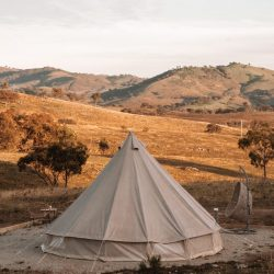 Sunset view of luxury glamping bell tent