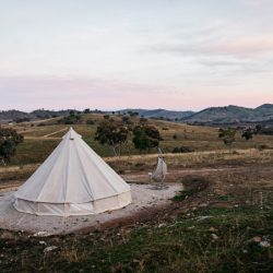 Panorama with tent and pink sky