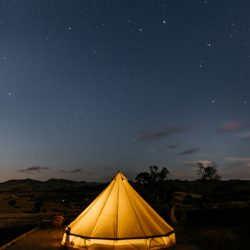 night time view of lit up bell tent from inside