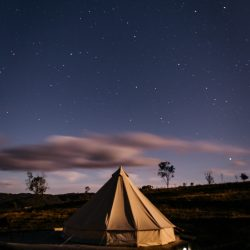 Evening outdoor image of bell tent and starry sky
