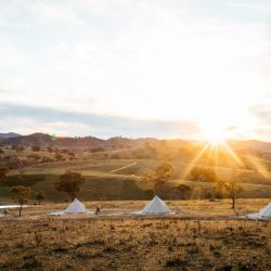 Sunset vista of Glemayr Farm with bell tents in foreground